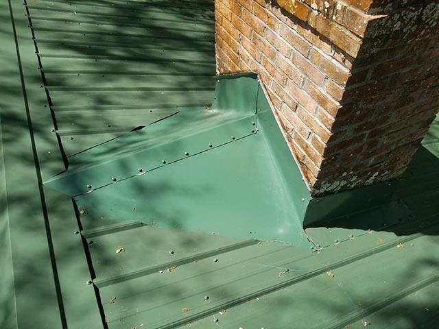 green metal roof, chimney flashing detail